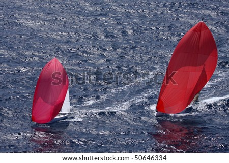 Boats sailing in regatta off of St. Thomas. - stock photo