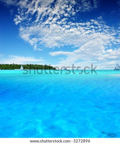Boats sailing near tropical Island - stock photo
