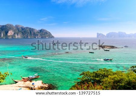 boats, sea and cliffs at koh Phi-Phi, Thailand - stock photo