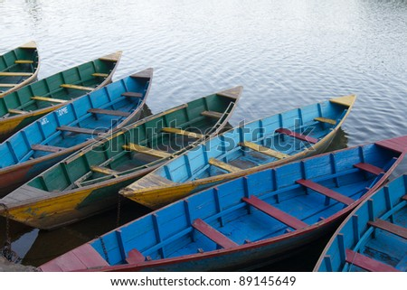 Boats stand at the pier on the lake - stock photo