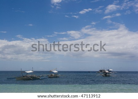 boats wading in the shallow