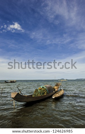 boats with fishing net on the bay - stock photo