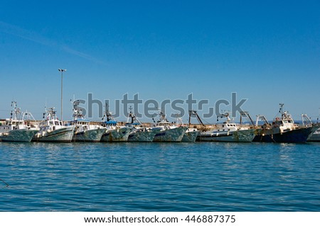Boats, yachts on turquoise blue water with sun specks, reflections on boards against clear blue sky on the background. Summer vacation scene with copy space - stock photo
