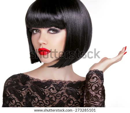 Bob hairstyle. Brunette fashion model with black short hair and red lips isolated on white background. Hand present.  - stock photo