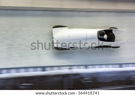 bob running on ice track competition - stock photo