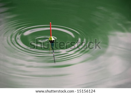 bobber signs in green waves - stock photo