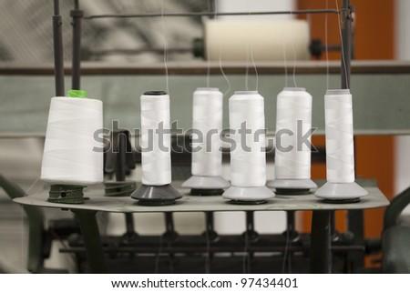 bobbin on the machine - stock photo