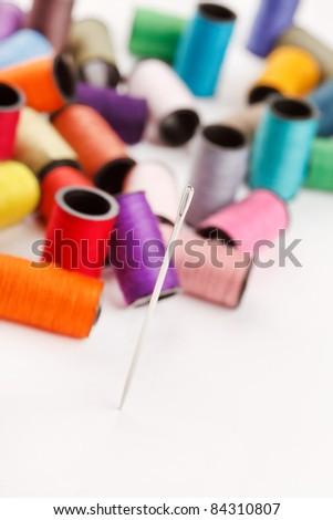 bobbins of lurex thread - stock photo