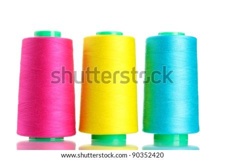 Bobbins of thread isolated on white - stock photo