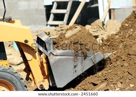 Bobcat Construction Machine  Scooping Dirt - stock photo