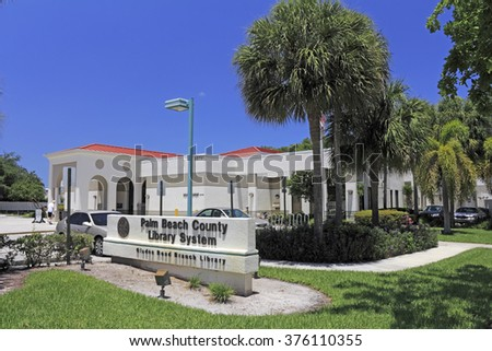 Boca Raton, FL, USA - May 9, 2015: Glades Road branch public library sign and building on a sunny day. The Boca Raton Glades Road library located in Palm Beach County.