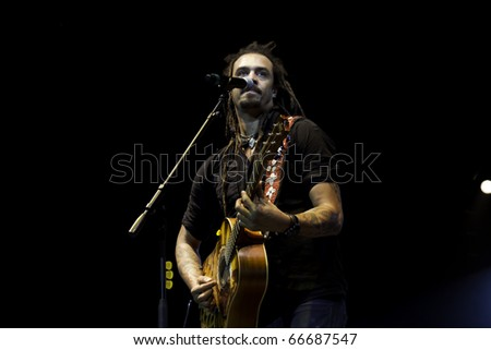 BOCA RATON, FLORIDA, USA - DECEMBER 4: Michael Franti and Spearhead performs on stage at No Snow Ball 2010 - December 4th, 2010 in Boca Raton, Florida, USA. - stock photo