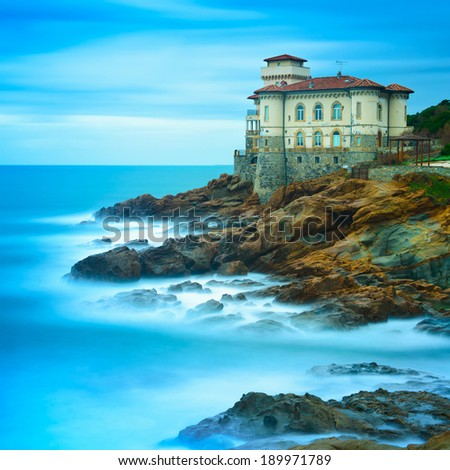 Boccale castle landmark on cliff rock and sea in winter. Tuscany, Italy, Europe - stock photo