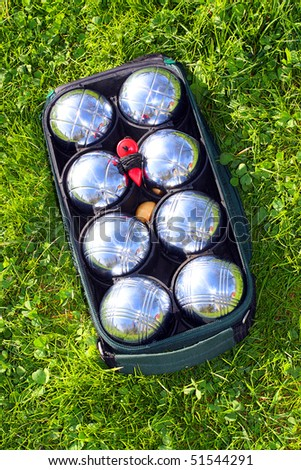 Bocce balls on a green grass. - stock photo