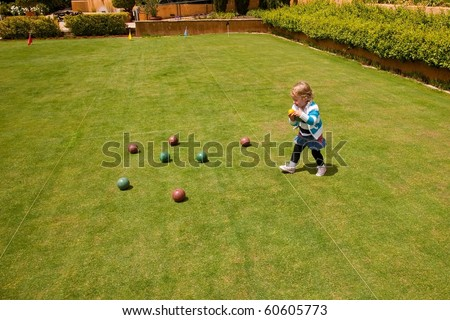 Bocce  is a ball sport belonging to the boules sport family, closely related to bowls and p?tanque  with a common ancestry from ancient games played in the Roman Empire. - stock photo