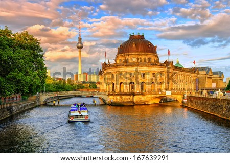 Bode museum on Spree river and Alexanderplatz TV tower in center of Berlin, Germany  - stock photo