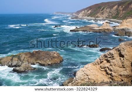 bodega head peninsula and rock outcroppings along shore of pacific ocean in sonoma coast state park california  - stock photo