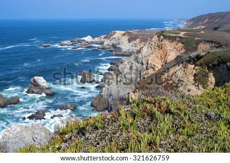 bodega head peninsula and rocky shoreline off pacific ocean in sonoma coast state park of california  - stock photo