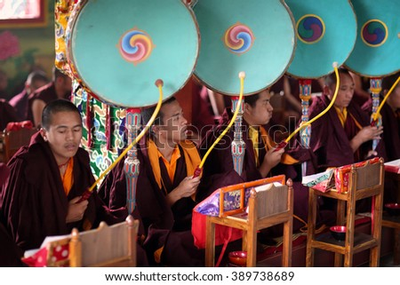 BODH GAYA - INDIA - DECEMBER 8, 2015: Unidentified Tibetan monks on December 8, 2015 in Bodh Gaya, India. For Buddhists Bodh Gaya is the most important pilgrimage site where Buddha was enlightened - stock photo