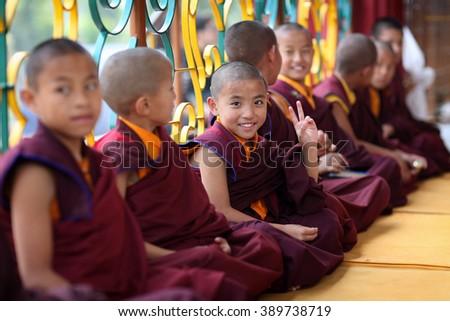 BODH GAYA - INDIA - DECEMBER 8, 2015: Unidentified Tibetan novices on December 8, 2015 in Bodh Gaya, India. For Buddhists Bodh Gaya is the most important pilgrimage site where Buddha was enlightened - stock photo