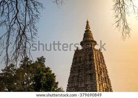 Bodhgaya at sunset, Budhagaya stupa is Public Buddhism landmark in India, The place Buddha attained enlightenment, Mahabodhi temple, Gaya, India - stock photo