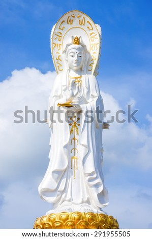 Bodhisattva, white sculture of Chinese god with blue sky