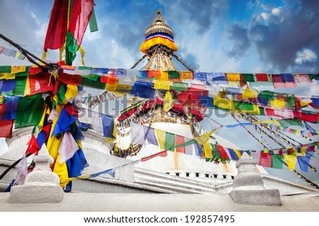 Bodhnath stupa with Tibetan prayer flags in Kathmandu valley, Nepal