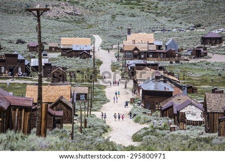 BODIE, CALIFORNIA, USA - July 6, 2015:  Groups of summer tourists visiting Bodie ghost town in California's Bodie State Historic Park. - stock photo