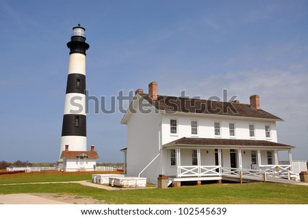 Bodie Island Lighthouse and keeper's quarters in Cape Hatteras National Seashore, south of Nags Head, North Carolina, USA - stock photo