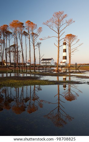 Bodie Island Lighthouse Golden Sunset Reflections Outerbanks North Carolina - stock photo