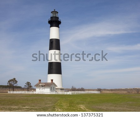 Bodie Island Lighthouse in Cape Hatteras North Carolina.  Open for public climbing for the first day ever. - stock photo