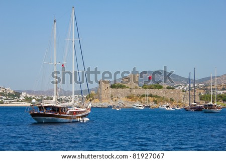 Bodrum castle and sailing boats - stock photo