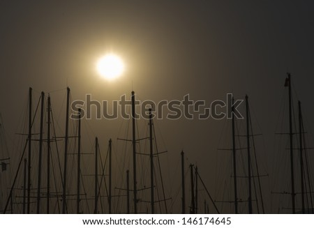 Bodrum Marina with docked yachts at the end of the day  - stock photo