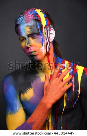 Body Art of a Man Painted With Holi Colors