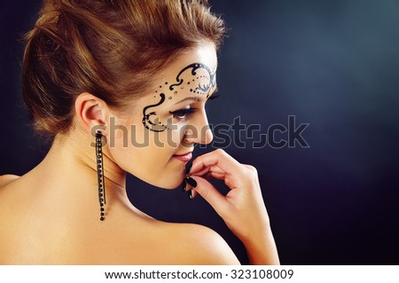 Body art on the face of the girl portrait - stock photo