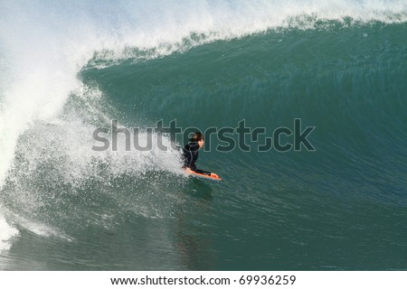 body boarder in action on a huge wave