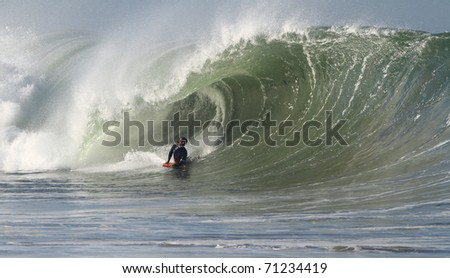 body boarder on a powerful wave