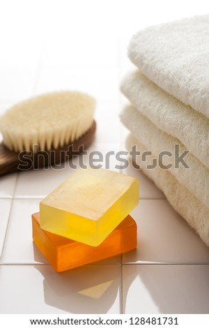 Body brush and soap and towel - stock photo