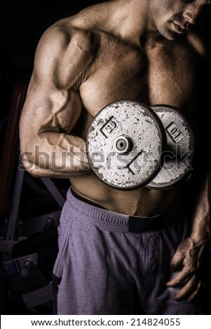 Body Builder Performing Heavy Dumbbell Bicep Curls Dumbbell Bicep Curls - stock photo
