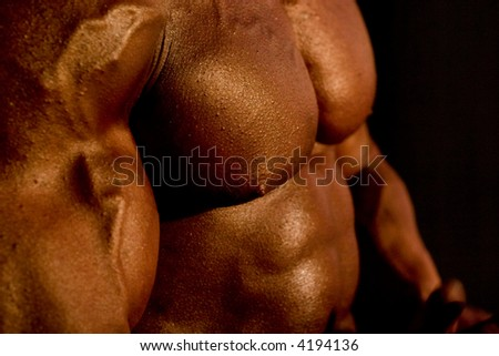 body-builder's body, very low DOF, close-up, focal point is on the nipple, 400 iso, real reporting from competitions - stock photo
