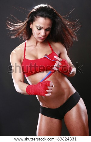 Body builder with boxing wraps