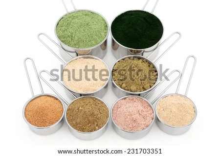 Body building and health food supplement powders over white background. Wheatgrass, spirulina, macca root, hemp, pomegranate, ginkgo biloba, chocolate whey, ginseng. Top to bottom, left to right  - stock photo