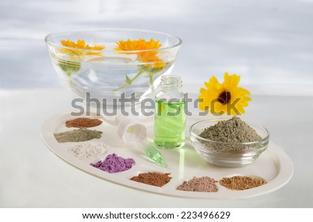 Body care and spa treatment concept, range of colored French clay and essential oil for mud therapy - stock photo