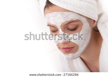 Body care - Beautiful woman with facial mask