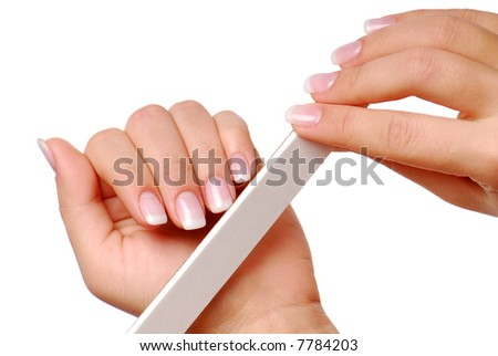 Body-care of hands. Woman polishing fingernails with the nail file.