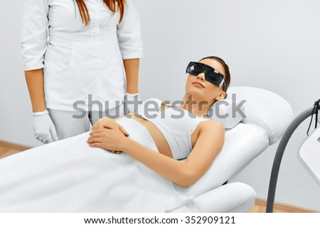 Body Care. Patien Before Underarm Laser Hair Removal. Removing Hair Of Young Woman's Armpit. Laser Epilation Treatment In Cosmetic Beauty Clinic. Hairless Smooth And Soft Skin.  - stock photo