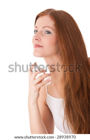 Body care series - Young red hair woman applying perfume on white background