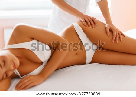 Body care. Spa massage treatment. Close-up of beautiful young healthy caucasian woman getting anti-cellulite massaging procedure. Body contouring treatment. Body care, skin care, wellness concept.  - stock photo