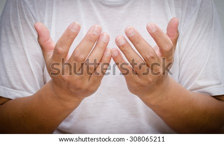 Body language of man - he gesticulate to show better the sense of his words  - stock photo
