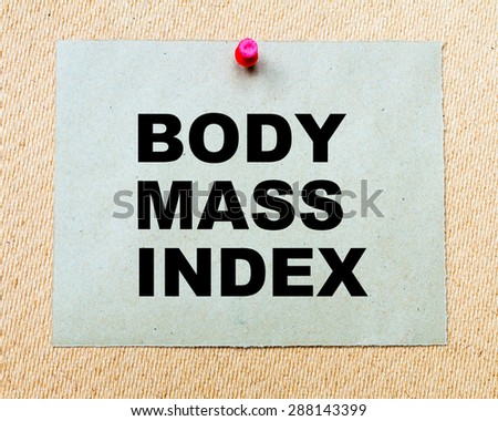 Body Mass Index written on paper note pinned with red thumbtack on wooden board. Business conceptual Image - stock photo